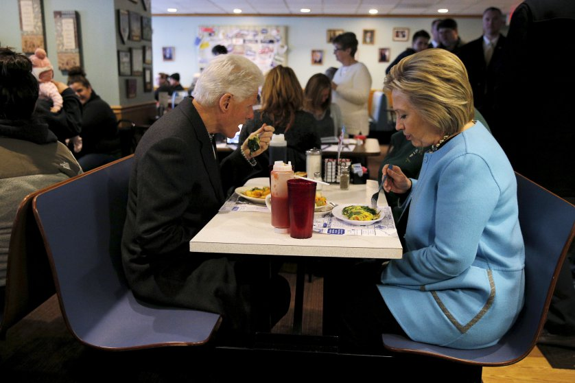 U.S. Democratic presidential candidate Hillary Clinton and her husband, former U.S. President Bill Clinton eat breakfast at the Chez Vachon restaurant in Manchester
