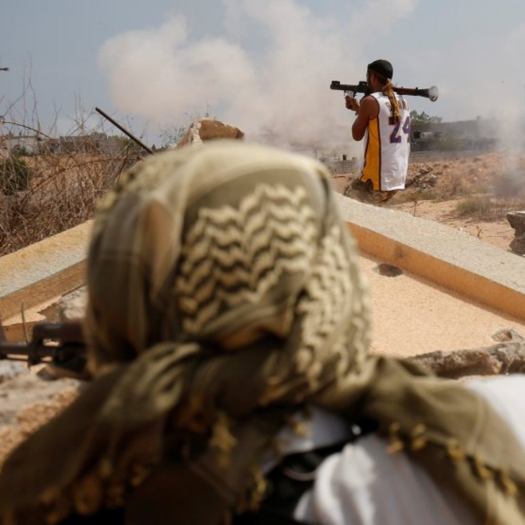 Libyan forces allied with the U.N.-backed government fire weapons during a battle with Islamic State fighters in Sirte