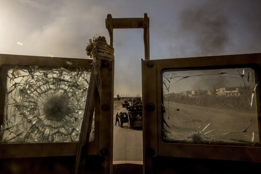 Iraqi ordnance disposal specialists clear a section of the Erbil-Mosul highway on the western edge of Bartella, Iraq.